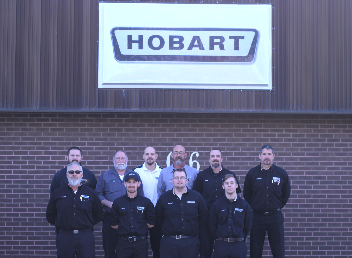 Employees in front of Hobart Sign.png